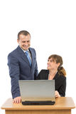 Two business people. Looking at computer screen and showing happy expression and smiling. concept for team work, business, and work related Royalty Free Stock Photo