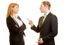 Two business people arguing. In a discussion Royalty Free Stock Photography