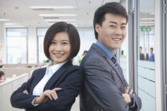 Two Business People with Arms Crossed Royalty Free Stock Image