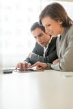 Two Business People Browsing Something Using Tablet Stock Photography