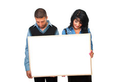 Two business people with cardboard stock photos