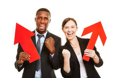 Two business people cheering with arrows Royalty Free Stock Image