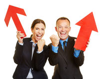 Two business people cheering with red arrow Stock Photography