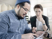 Two business people with digital tablet Royalty Free Stock Images