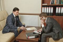 Two business people direct negotiations in the office.  stock image