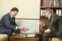 Two business people direct negotiations in the office Stock Photo