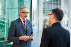 Two business people discussing outdoor Royalty Free Stock Photography