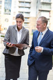 Two business people discussing outside the office Stock Photos