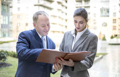 Two business people discussing outside the office Stock Images