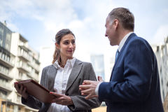 Two business people discussing outside the office Stock Photo