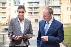 Two business people discussing outside the office Royalty Free Stock Image