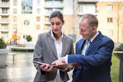 Two business people discussing outside the office Royalty Free Stock Photography