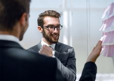 Two business people discussing something standing in the office. The concept of cooperation royalty free stock photo