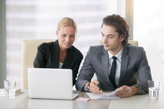 Two business people discussing work plans Royalty Free Stock Photography