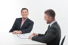 Two business people in elegant suits, chief and Royalty Free Stock Image