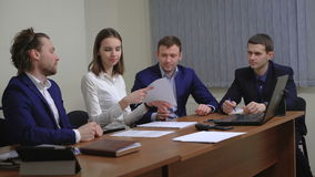 Two business people in elegant suits. Working in team together with documents sign up contract. stock footage