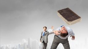 Two business people fighting with each other Stock Images