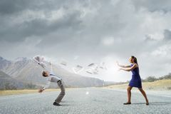 Two business people fighting with each other Royalty Free Stock Photography