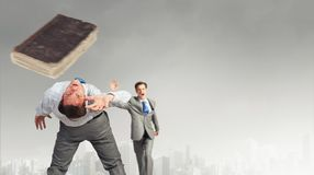 Two business people fighting with each other Royalty Free Stock Image