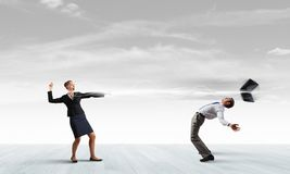 Two business people fighting with each other Stock Photo