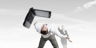 Two business people fighting with each other Stock Photos