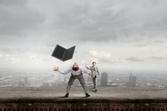 Two business people fighting with each other Royalty Free Stock Photos