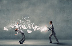Two business people fighting with each other Royalty Free Stock Photo