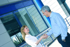 Two Business People Greet royalty free stock photo