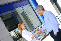 Two Business People Greet-2 stock image