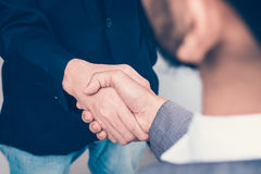 Two business people handshake success story. Business people handshake success story Stock Image