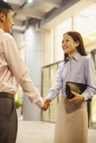 two business people handshaking outside the office Stock Photos