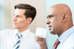 Two business people having informal coffee meeting Stock Photos