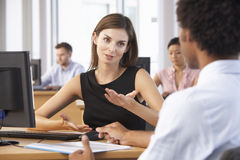Two Business People Having Meeting In Busy Office royalty free stock photos