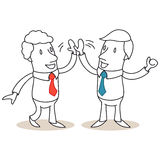 Two business people high-fiving Stock Images