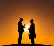 Two Business People on the Hill Stock Images