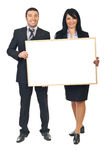 Two business people holding banner. Two smiling business people holding blank banner isolated on white background stock image