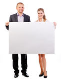 Two business people holding banner. Isolated on white background royalty free stock photos
