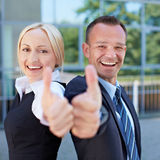Two business people holding thumbs royalty free stock images