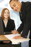 Two Business People In Office Working Stock Images