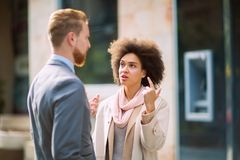 Business people in an informal conversation Stock Images