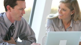Two Business People With Laptop Having Meeting stock footage