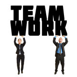 Two business people lifting word Teamwork Royalty Free Stock Photos