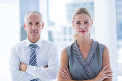 Two business people looking at the camera Royalty Free Stock Photography