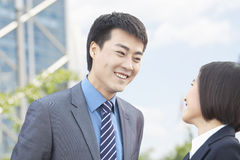 Two Business People Looking at Each Other Royalty Free Stock Photos