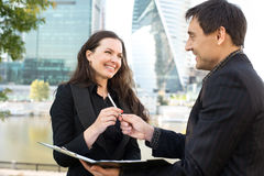 Two business people looking at papers Royalty Free Stock Photos
