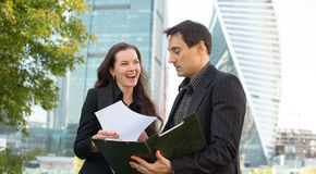 Two business people looking at papers Royalty Free Stock Photo