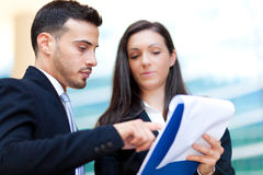 Two Business People looking some documents. Group of Business People outdoor royalty free stock photo
