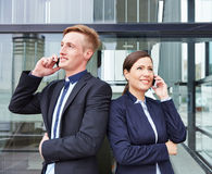 Two business people making calls Royalty Free Stock Photography