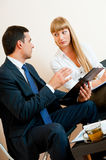 Two business people are meeting. In the office Royalty Free Stock Photography