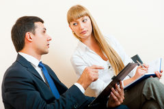 Two business people are meeting. In the office Royalty Free Stock Images